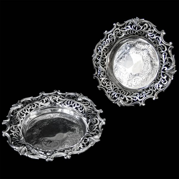 A pair of Barnard Brothers pierced silver wine coasters