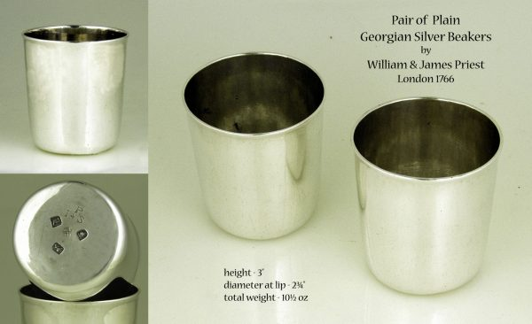 A pair of antique silver beakers