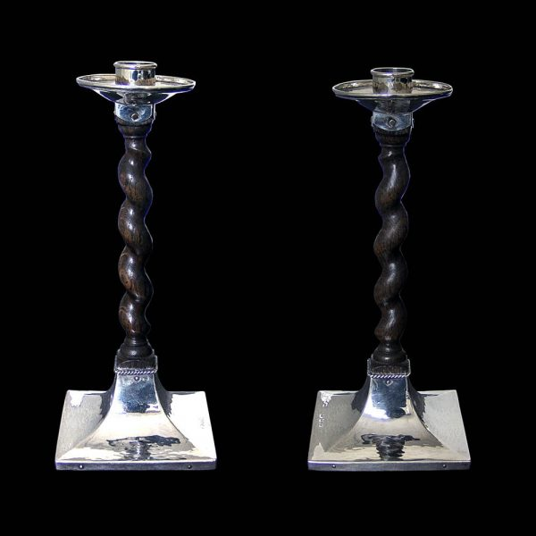 Pair of A E Jones Arts & Crafts Candlesticks