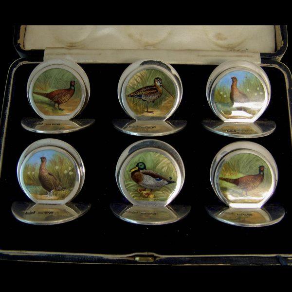 Set of  six silver and enamel game menus