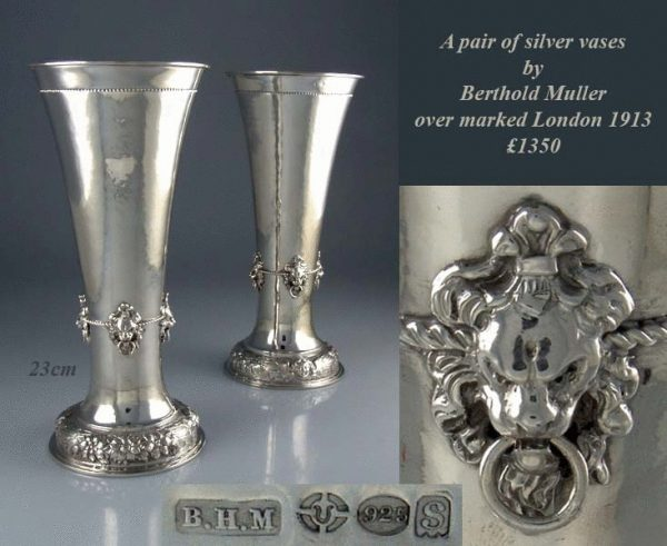 A pair of silver vases by Berthold Muller