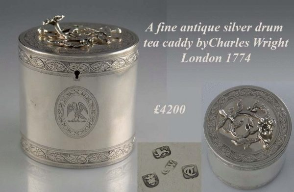 An antique silver drum tea caddy