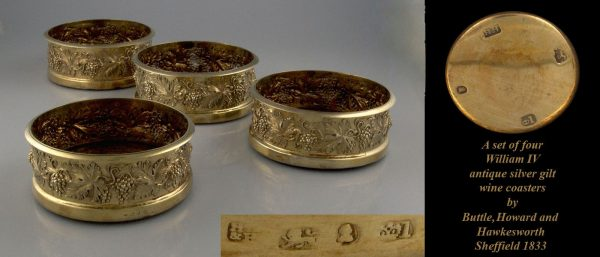 A set of four William IV silver gilt wine coasters