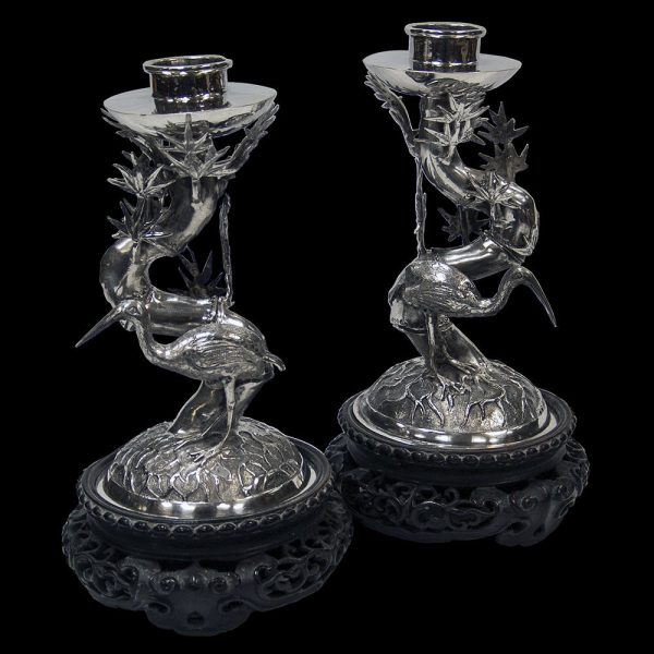A pair of Chinese Export Silver Candlesticks